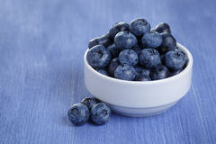 Organic ripe blueberries in bowl Royalty Free Stock Image