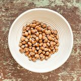 Wicked basket with ripe unpeeled hazelnuts royalty free stock photo