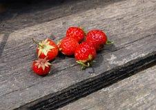 organic ripe strawberries on vintage board Stock Image