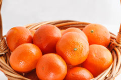 Organic ripe mandarins in basket on white background Royalty Free Stock Photography