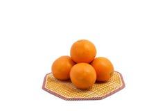 Organic ripe orange on mat. On white background Stock Photos