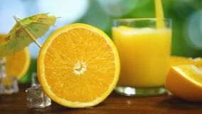 Organic Fresh Orange Fruit and juice pour into glass on background