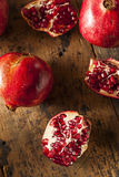 Organic Ripe Red Pomegranates Royalty Free Stock Photography
