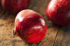 Organic Ripe Red Pomegranates Stock Images