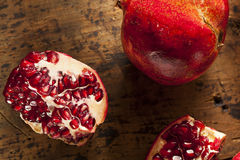 Organic Ripe Red Pomegranates Royalty Free Stock Photos