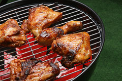 Organic roasted chicken parts on a barbecue stock photography