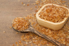 Organic rock candy sugar in wooden spoon Royalty Free Stock Image