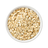 Organic Rolled Oats in a ceramic bowl Royalty Free Stock Image