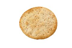 Organic round biscuit. Isolated on pure white stock photography