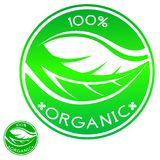 100% Organic round green icon. In the form of a seal, which shows a leaf with veins vector illustration