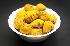 Organic Round Turmeric in ceramic bowl Royalty Free Stock Images