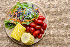 Organic Salad on wooden plate. Five colur of vegetables stock photos