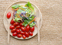 Organic Salad on wooden plate. And natural floor Stock Photography