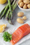 Organic Salmon fillet, potatoes & asparagus Stock Photos