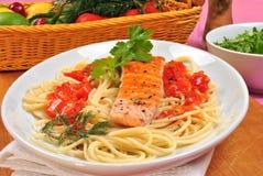 organic salmon on some tomato spaghetti Royalty Free Stock Photos