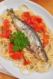 organic sardine on some tomato spaghetti Royalty Free Stock Photos