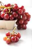 Organic, seedless purple grapes in recyclable box with a small c Stock Photography