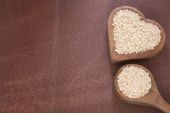 Organic sesame seed on wooden table. Sesame seeds contain a high amount of protein Royalty Free Stock Photography