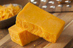 Organic Sharp Cheddar Cheese Stock Image