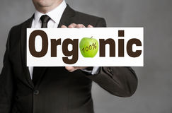 Organic signboard is held by businessman Stock Photo