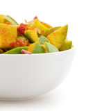 Organic sliced Indian Mango (Mangifera indica) in white bowl. Organic sliced Indian Mango (Mangifera indica), seasoned with turmeric, salt and red chili pepper Royalty Free Stock Images