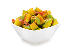 Organic sliced Indian Mango (Mangifera indica) in white bowl. Organic sliced Indian Mango (Mangifera indica), seasoned with turmeric, salt and red chili pepper Royalty Free Stock Photography