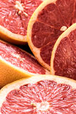 Organic sliced red grapefruits Stock Images