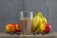 Organic smoothie apple,bluberry and banana juice glass on wood Royalty Free Stock Photography