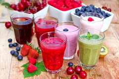 Organic smoothies, fruit yogurt and juices. On table Stock Photography