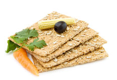 Organic snack with cheese crackers. Healthy snacks - organic cheese crackers with olives, carrots and baby corn. Isolated on white background stock images