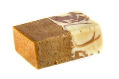 Organic soap. A bar of home-made organic vanilla & sandalwood soap, looks good enough to eat royalty free stock photo