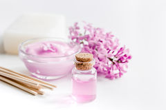 Organic soap, cream, extract in lilac cosmetic set with flowers on white table background Stock Photos