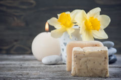 Organic soap and yellow flowers Stock Image