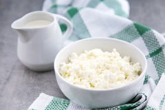 Organic Sour cream and Cottage Cheese in a white ceramic bowl on the kitchen table. Dairy products for the healthy breakfast. Stock Image