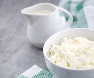 Organic Sour cream and Cottage Cheese in a white ceramic bowl on the kitchen table. Dairy products for the healthy breakfast. Royalty Free Stock Photography