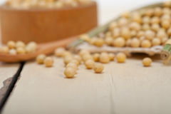 Organic soya beans. Over rustic wood table macro closeup stock photography