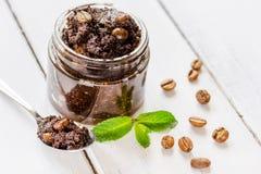 Organic spa with coffee scrub in cosmetic set on table Stock Image