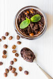 Organic spa with coffee scrub in cosmetic set on table top view Royalty Free Stock Image