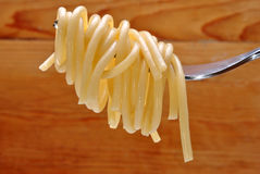organic spaghetti wrapped around a fork Stock Image