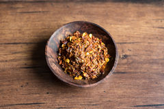 Organic spicy red pepper flakes used for cooking Royalty Free Stock Images