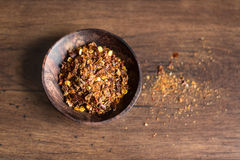 Organic spicy red pepper flakes used for cooking Royalty Free Stock Image
