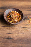 Organic spicy red pepper flakes Royalty Free Stock Image