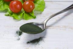 Organic spirulina algae powder in  spoon Royalty Free Stock Image