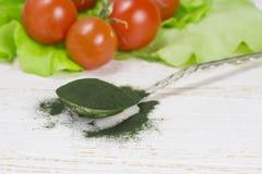 Organic spirulina algae powder in  spoon Stock Photography