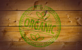 Organic stamp. On wooden background royalty free stock photography