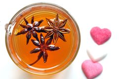 Organic star anise tea on a white background. Star anise, star aniseed, or Chinese star anise is a spice that closely resembles anise in flavor, obtained from Stock Images