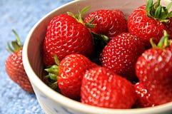 Organic Strawberries. In rustic bowl Royalty Free Stock Photos