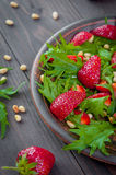 Organic strawberry salad with arugula nuts. Useful strawberry salad with arugula nuts and honey royalty free stock photo