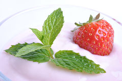 Organic strawberry in yogurt and mint Stock Images