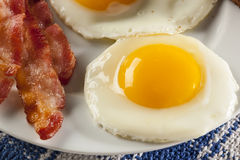 Organic Sunnyside up Egg with toast and bacon Royalty Free Stock Image